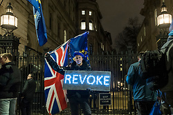 © Licensed to London News Pictures. 20/03/2019. LONDON, UK.  Pro-Remain protesters outside Downing Street.  Inside Number 10, Theresa May, Prime Minister is making a statement to the nation about Brexit.  Photo credit: Stephen Chung/LNP