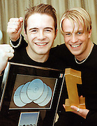 Westlife's Shane Filan and Kian Egan, celebrate as their single goes to number one for Christmas in the UK charts, at Kian's home in Sligo, yesterday. Photo: James Connolly/GreenGraph