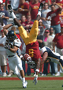 10/8/04--Los Angeles CA--USC receiver Dwayne Jarrett is upended by call Ryan Gutierrez after a catch in the 1st quarter. Photo by John McCoy/Staff Photographer Los Angeles Daily News