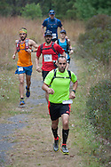 Kerhonkson, New York - Jason Beaupre of Gardiner takes the lead at Minnewaska State Park Preserve in the Shawangunk Ridge Trail Run/Hike 20-mile race on Sept. 20, 2014.