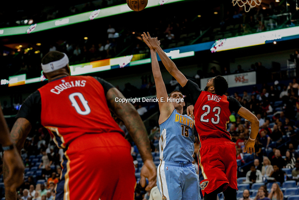 Apr 4, 2017; New Orleans, LA, USA; New Orleans Pelicans forward Anthony Davis (23) blocks a shot by Denver Nuggets forward Nikola Jokic (15) during the first quarter of a game at the Smoothie King Center. Mandatory Credit: Derick E. Hingle-USA TODAY Sports