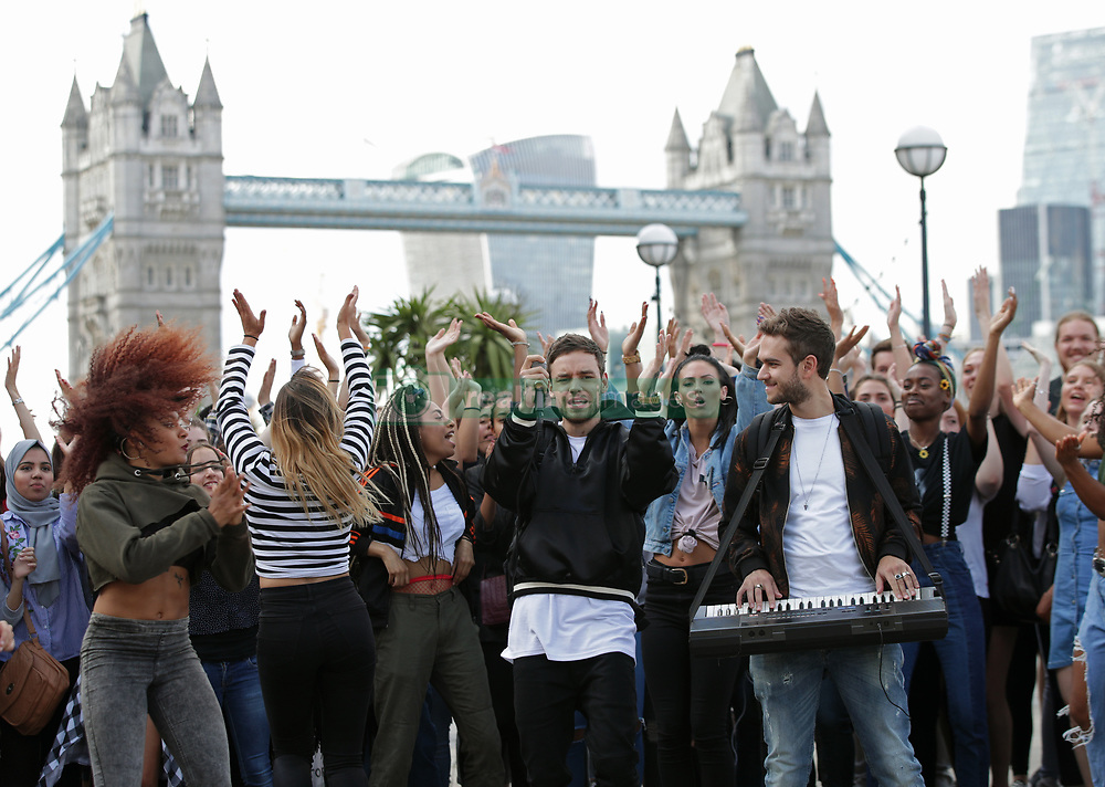 Liam Payne (centre left) and Zedd filming for their music video 'Get Low' at Butler's Wharf in London.