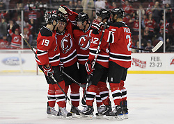 Feb 16; Newark, NJ, USA; New Jersey Devils left wing Ilya Kovalchuk (17) is congratulated by teammates after scoring a goal during the second period at the Prudential Center.