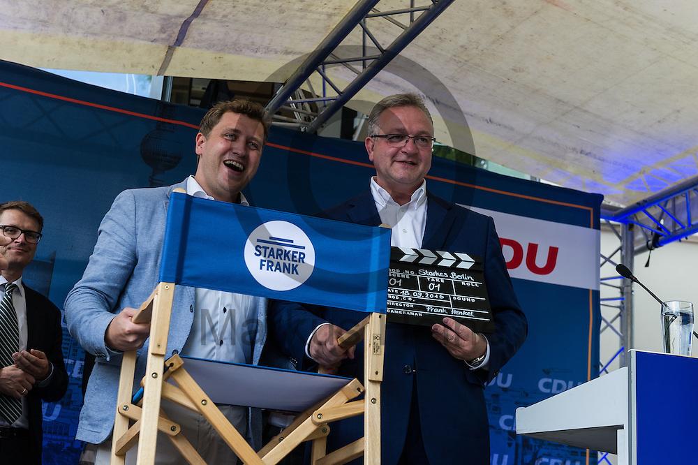 Dr. Gottfried Ludewig (l, MdA, CDU) &uuml;berreicht w&auml;hrend des CDU Sommerfest am 30.06.2016 in Berlin, Deutschland dem Senator f&uuml;r Inneres und Sport Frank Henkel (CDU) einen Regiestuhl. Foto: Markus Heine / heineimaging<br /> <br /> ------------------------------<br /> <br /> Ver&ouml;ffentlichung nur mit Fotografennennung, sowie gegen Honorar und Belegexemplar.<br /> <br /> Bankverbindung:<br /> IBAN: DE65660908000004437497<br /> BIC CODE: GENODE61BBB<br /> Badische Beamten Bank Karlsruhe<br /> <br /> USt-IdNr: DE291853306<br /> <br /> Please note:<br /> All rights reserved! Don't publish without copyright!<br /> <br /> Stand: 06.2016<br /> <br /> ------------------------------w&auml;hrend des Sommerfest der CDU Pankow am 30.06.2016 in Berlin, Deutschland. Foto: Markus Heine / heineimaging<br /> <br /> ------------------------------<br /> <br /> Ver&ouml;ffentlichung nur mit Fotografennennung, sowie gegen Honorar und Belegexemplar.<br /> <br /> Bankverbindung:<br /> IBAN: DE65660908000004437497<br /> BIC CODE: GENODE61BBB<br /> Badische Beamten Bank Karlsruhe<br /> <br /> USt-IdNr: DE291853306<br /> <br /> Please note:<br /> All rights reserved! Don't publish without copyright!<br /> <br /> Stand: 06.2016<br /> <br /> ------------------------------