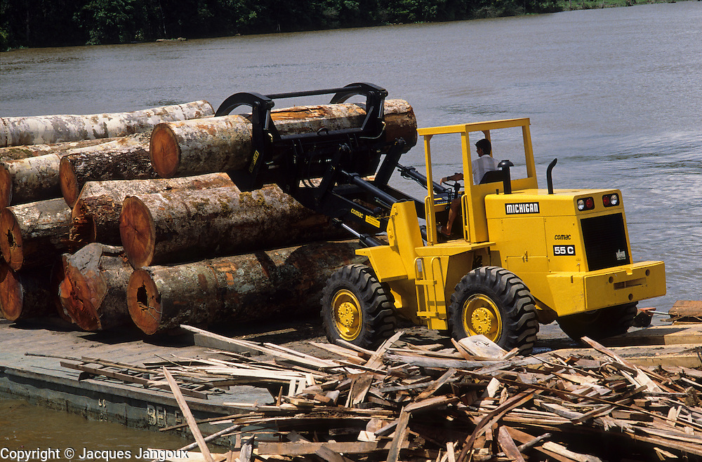 Deforestation: log loader unloading logs from barge at sawmill, Amazon estuary, Marajo Island, Para, Brazil