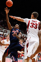 February 3, 2011; Stanford, CA, USA;  Arizona Wildcats forward Derrick Williams (23) shoots over Stanford Cardinal forward Dwight Powell (33) during the second half at Maples Pavilion.  Arizona defeated Stanford 78-69.