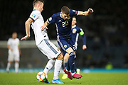 Andrey Semenov of Russia (5) (Akhmat Grozny) blocks the run of Scotland midfielder Ryan Christie (20) (Celtic) during the UEFA European 2020 Qualifier match between Scotland and Russia at Hampden Park, Glasgow, United Kingdom on 6 September 2019.
