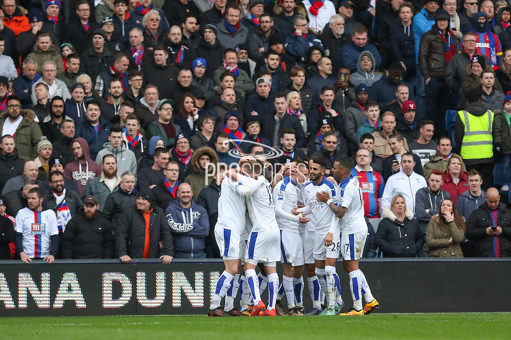 Leicester City midfielder Riyad Mahrez (26) celebrates his goal 0-1 with Leicester City forward Jamie Vardy (9) during the Barclays Premier League match between Crystal Palace and Leicester City at Selhurst Park, London, England on 19 March 2016. Photo by Phil Duncan.