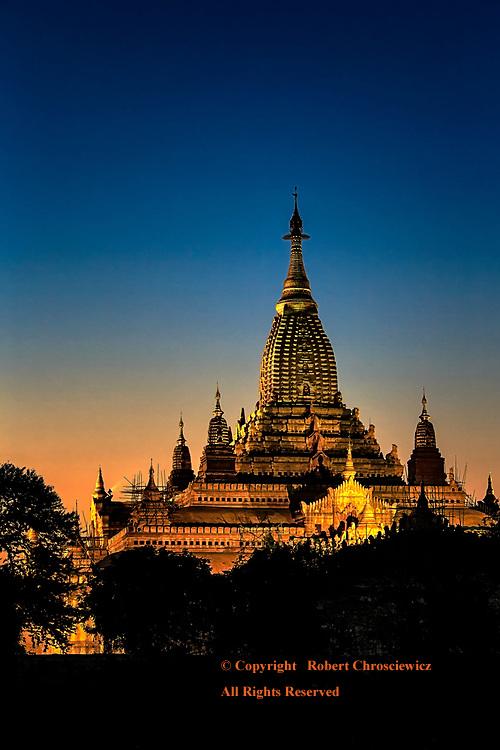 Ananda Sunset: The vibrant skies of sunset encompass the golden Buddhist Ananda Temple, Bagan Myanmar.