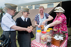 Northern World War II Association (NWW2A) members Christine Field (right) and Nina Turton (far right) relieving Axis Reenactors Denise Guthrie and Aileen Brawley of their Riechsmarks in aid of Cancer Care UK.Christine and Nina will be selling traditional sweets to raise funds for the Charity during the 2013 season. Christine came up with the idea half way through the 2012 re-enacting season and raised £230 for the Charity..5 May 2013.Image © Paul David Drabble