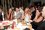 CAT DEELEY BIDDING IN THE AUCTION, The Tomodachi ( Friends) Charity Dinner hosted by Chef Nobu Matsuhisa in aid of the Unicef  Japanese Tsunami Appeal. Nobu Berkeley St. London. 5 May 2011. <br /> <br />  , -DO NOT ARCHIVE-© Copyright Photograph by Dafydd Jones. 248 Clapham Rd. London SW9 0PZ. Tel 0207 820 0771. www.dafjones.com.