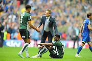 AFC Wimbledon manager Neal Ardley shakes hands with Plymouth Argyle's Curtis Nelson and Plymouth Argyle's Jamille Matt after the final whistle during the Sky Bet League 2 play off final match between AFC Wimbledon and Plymouth Argyle at Wembley Stadium, London, England on 30 May 2016. Photo by Graham Hunt.