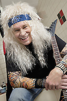 Portrait of hippie guitarist laughing