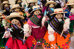 Dolls on display at market, Cuenca, Ecuador, South America