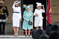© Licensed to London News Pictures. 03/06/2019. London, UK.  First Lady Melania Trump, Queen Elizabeth II and Camilla, Duchess of Cornwall attend a ceremonial welcome at Buckingham Palace. The visit is on the first day of a three day state visit. Photo credit: Ray Tang/LNP