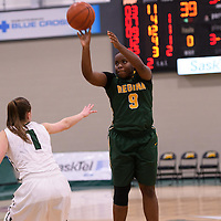 1st year guard Kyanna Giles (9) of the Regina Cougars in action during the home game on December  3 at Centre for Kinesiology, Health and Sport. Credit: Matt Johnson/Arthur Images
