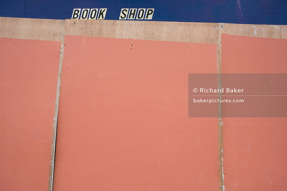 A boarded-up bookshop in Hackney, a few days after the London riots.