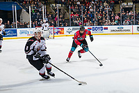 KELOWNA, CANADA - MARCH 16:  Alex Swetlikoff #17 of the Kelowna Rockets checks Tristen Nielsen #8 of the Vancouver Giants as he skates with the puck during third period on March 16, 2019 at Prospera Place in Kelowna, British Columbia, Canada.  (Photo by Marissa Baecker/Shoot the Breeze)