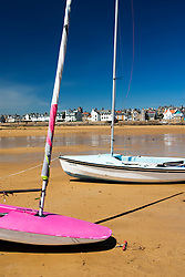 Sailing boats on the beach in the village of Elie in Fife Scotland