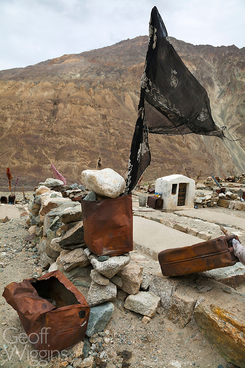 Muslim graveyard close to Pakistan border embellished with used jerrycans and ration tins, Turtuk, Ladakh, India