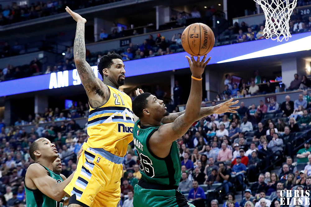 10 March 2017: Boston Celtics guard Marcus Smart (36) goes for the layup past Denver Nuggets forward Wilson Chandler (21) during the Denver Nuggets 119-99 victory over the Boston Celtics, at the Pepsi Center, Denver, Colorado, USA.