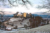 Lenzburg Castle, Switzerland sitting on it's hill and covered with a sugar-coating of snow.