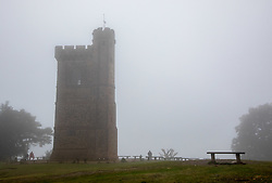 © Licensed to London News Pictures. 30/06/2020. Surrey, UK. On the summit of Leith Hill in the Surrey Hills, The 18th century Leith Tower is shrouded in an unseasonal midsummer's fog as it stands a 1000ft above sea level. Weather forecasters have predicted a mild but wet and windy week ahead for the South East. Photo credit: Alex Lentati/LNP