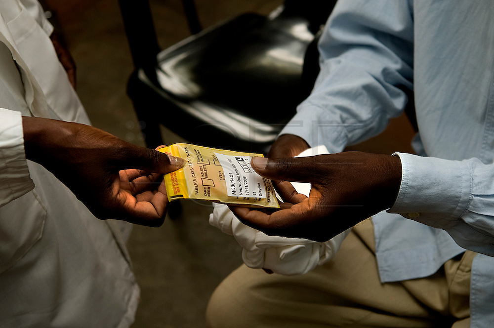 A jail prisoner receive his dose of anti-viral drugs for the  treatment of HIV