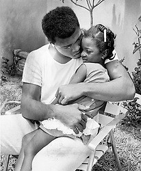 June 3, 2016 - File - MUHAMMAD ALI, the three time heavyweight boxing champion, has died at the age of 74. He had been fighting a respiratory illness. 'The Greatest' was the dominant heavyweight boxer of the 1960s and 1970s, Ali won an Olympic gold medal in Rome in 1960, captured the professional world heavyweight championship on three separate occasions, and successfully defended his title 19 times. PICTURED: July 9, 1966 - Florida, U.S. - A tender moment with the Champ. MUHAMMAD ALI hugs a 4-year-old admirer. (Credit Image: © The Palm Beach Post via ZUMA Wire)
