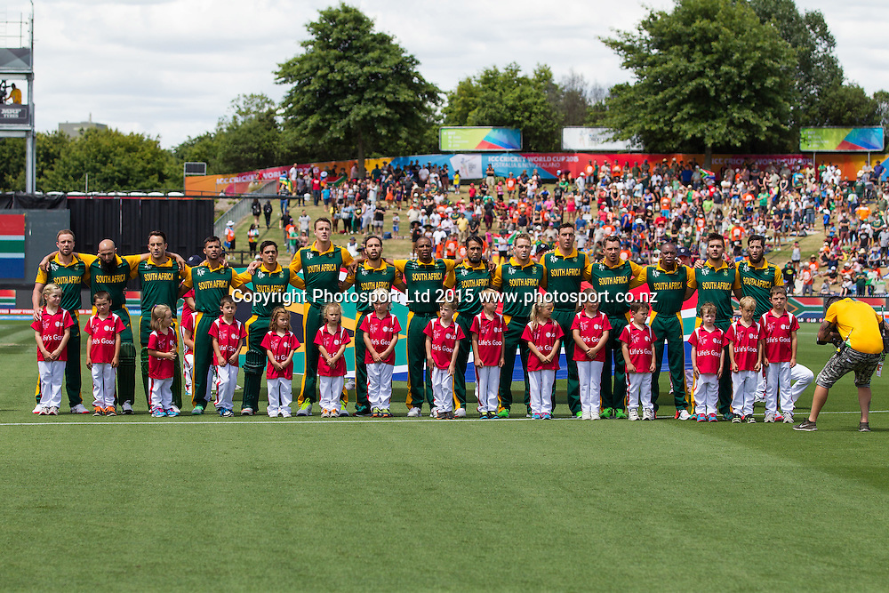 South African players line up during the national anthems shortly before the ICC Cricket World Cup match - South Africa v Zimbabwe at Seddon Park, Hamilton, New Zealand on Sunday 15 February 2015.  Photo:  Bruce Lim / www.photosport.co.nz