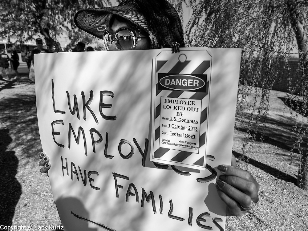 02 OCTOBER 2013 - GLENDALE, AZ:  A civilian employee at Luke Air Force Base was one of about 30 people who picketed the base Wednesday. The furloughed workers, all civilian employees and members of AFGE at Luke Air Force Base, protested the partial shutdown of the US government. The American Federation of Government Employees (AFGE) is the largest federal employee union representing 650,000 federal and D.C. government workers. Similar protests were held across the country as the partial government shutdown entered its second day.      PHOTO BY JACK KURTZ