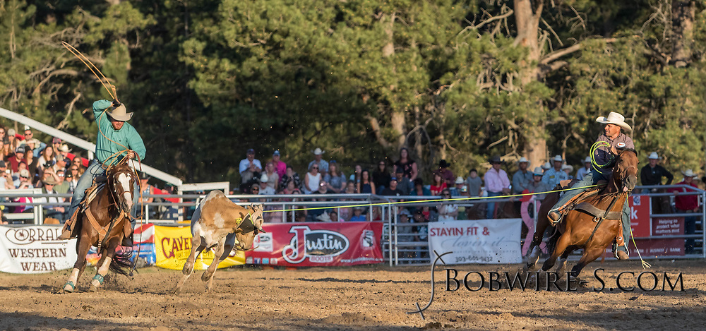 Header Lee Kiehne and heeler Tyler Getzwiller make their team roping run during the second performance of the Elizabeth Stampede on Saturday, June 2, 2018.