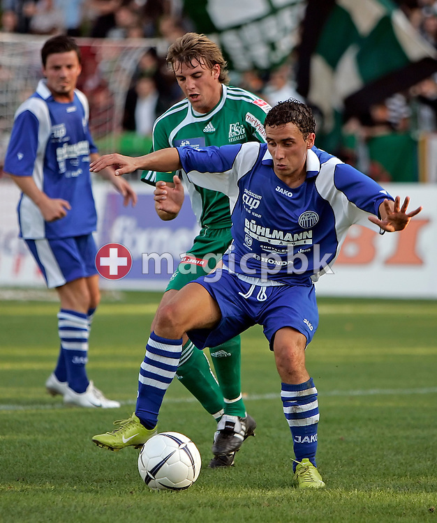 FCSG's player Dominique Longo (C) tries to interrupt FC Toess's Sandro Malis (R) who is playing the ball during the game between FC Toess and the FC St. Gallen at the Schuetzenwiese stadium in Winterthur, Switzerland, Saturday, September 15, 2007. FC St. Gallen wins the game against FC Toess by eight to nil. (Photo by Patrick B. Kraemer / MAGICPBK)