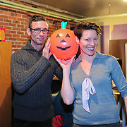 Chuck Palahniuk (L), pumpkin, and Virginia Prescott backstage at The Music Hall in Portsmouth, NH. Nov. 3, 2011