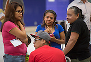 Houston ISD staff, community members, parents and students gather for the first 2012 Bond community meeting at Davis High School, July 15, 2014.