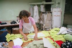 Female pattern cutter working in clothes factory in Havana; Cuba,