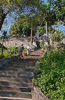 Nyoman and Made climbing the stairs to the Goa Giri Putri cave temple on Nusa Penida, Bali, Indonesia.jpg