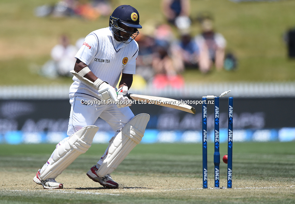 Rangana Herath is bowled by Southee on day 3 of the 2nd cricket test match between New Zealand Black Caps and Sri Lanka at Seddon Park in Hamilton, New Zealand. Sunday 20 December 2015. Copyright photo: Andrew Cornaga / www.photosport.nz