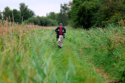 UK ENGLAND CAMBRIDGESHIRE WICKEN 7AUG06 - A birdwatcher walks through the Wicken Fen National Nature Reserve, managed by the National Trust is one of Britain's oldest nature reserve dating back to the late 1800s...jre/Photo by Jiri Rezac..© Jiri Rezac 2006..Contact: +44 (0) 7050 110 417.Mobile:  +44 (0) 7801 337 683.Office:  +44 (0) 20 8968 9635..Email:   jiri@jirirezac.com.Web:    www.jirirezac.com..© All images Jiri Rezac 2006 - All rights reserved.