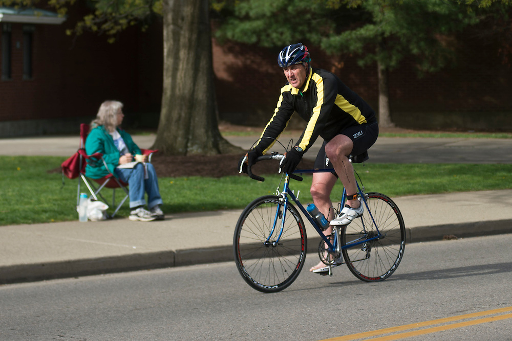 Martin Redden bikes during the O'Bleness Race for a Reason Triathlon Saturday, April 27, 2013. The triathlon included a 500mm Serpentine Swim at the Ohio University Aquatic Center, a 15 mile bike ride to the Plains and back and then a 5k run that finished at Tailgreat Park across from Peden Stadium. . Race for a Reason, Race 4 A Reason, Annual Events, Events, Students, Faculty & Staff