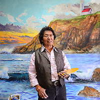 070114       Cayla Nimmo<br /> <br /> Richard Yazzie poses in front of his mural inside Nu Kreations Salon in Gallup Tuesday morning.