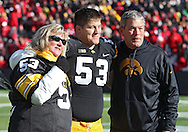 November 23 2012: Iowa Hawkeyes offensive linesman James Ferentz (53) stands with his parents, Mary Ferentz and head coach Kirk Ferentz after being introduced for senior day before the start of the NCAA football game between the Nebraska Cornhuskers and the Iowa Hawkeyes at Kinnick Stadium in Iowa City, Iowa on Friday November 23, 2012. Nebraska defeated Iowa 13-7 in the Heroes Game on Black Friday.