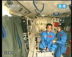 59870552  This TV grab taken on June 20, 2013 shows female astronaut Wang Yaping (R), one of the three crew members of Shenzhou-10 spacecraft, giving a lecture to students on Earth aboard China s space module Tiangong-1. A special lecture began Thursday morning, given by Wang Yaping aboard China s space module Tiangong-1 to students on Earth, Thursday June 20, 2013.<br /> UK ONLY