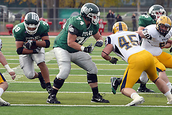 12 November 2011:  Jeremy Adams provides blocking for running back Sean Conley during an NCAA division 3 football game between the Augustana Vikings and the Illinois Wesleyan Titans in Tucci Stadium on Wilder Field, Bloomington IL