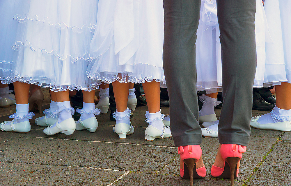 Girls get in line for their First Holy Communion in Gracia, Costa Rica Church.