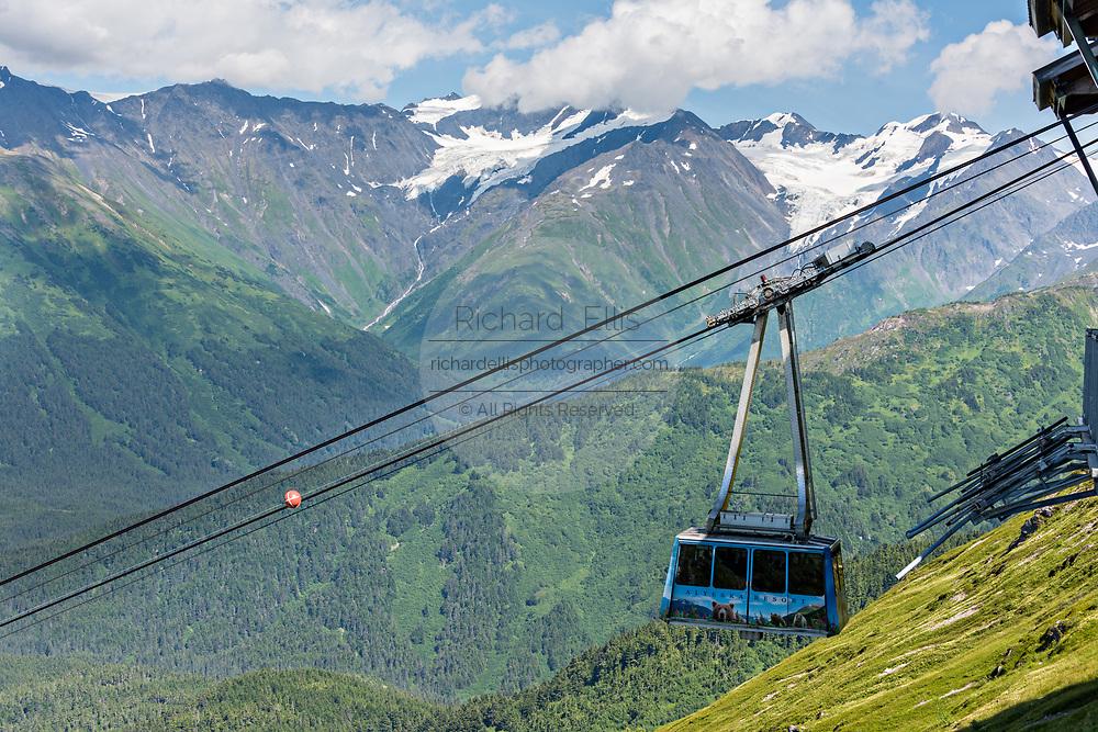 The Alyeska Aerial Tram climbs up the mountains in Girdwood, Alaska. The cable tram climbs 2,300 feet to the top of Mt. Alyeska in the Church Mountains.
