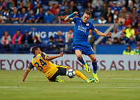 Football - 2016/2017 Premier League - Leicester Ciity V Arsenal. <br /> <br /> Jamie Vardy of Leicester City rides the challenge from Francis Coquelin of Arsenal at The King Power Stadium.<br /> <br /> COLORSPORT/DANIEL BEARHAM