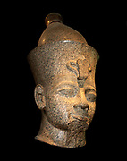 Red granite head from a colossal figure of a king. Eighteenth Dynasty, about 1390 BC. From Thebes, Temple of Mut. This enormous head wearing the double crown and the larger arm both belong to a colossal standing figure, one of a pair, set up before the temple of Khonspekhrod in the precincts of the Temple of Mut.