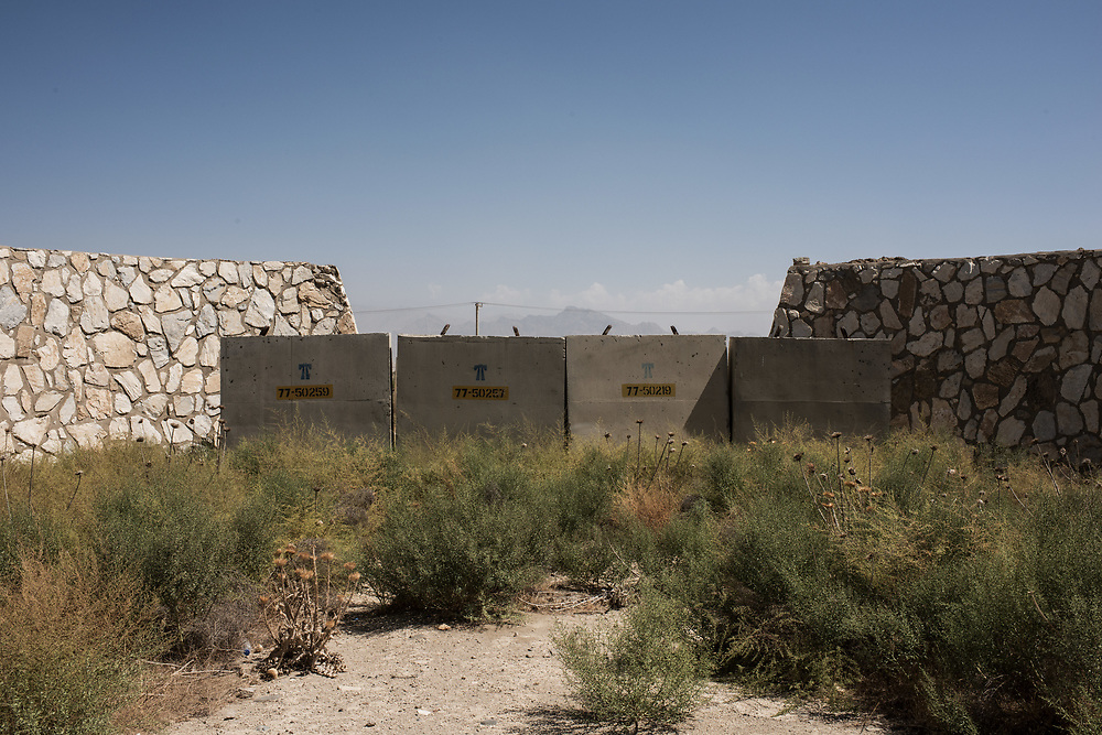 BAGRAM, AFGHANISTAN - SEPTEMBER 5: Remnants of dilapidated buildings sit at an unused section of Bagram Air Field on September 5, 2017 in Bagram, Afghanistan. Currently the United States has about 11,000 troops in the deployed in Afghanistan, with a reported 4,000 more expected to arrive in the coming weeks. Last month, President Donald Trump announced his plan for Afghanistan which called for an increase in troop numbers and a new conditions-based approach to the war, getting rid of a timetable for the withdrawal of American forces in the country.(Photo by Andrew Renneisen/Getty Images)