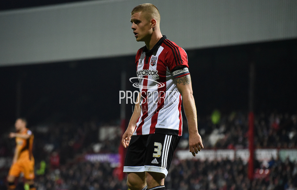 Jake Bidwell watches the action unfold during the Sky Bet Championship match between Brentford and Hull City at Griffin Park, London, England on 3 November 2015. Photo by Michael Hulf.